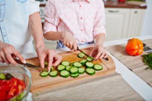 Cutting cucumber together